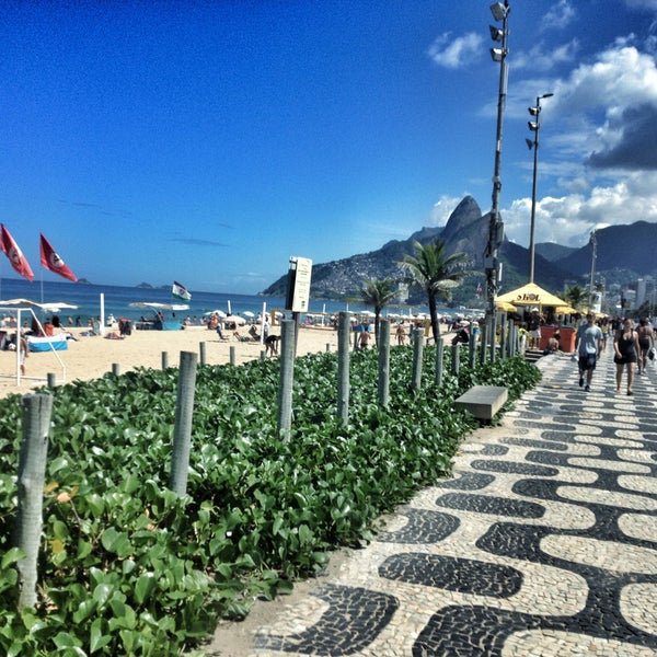 Photo taken at Praia de Ipanema by George S. on 4/22/2013