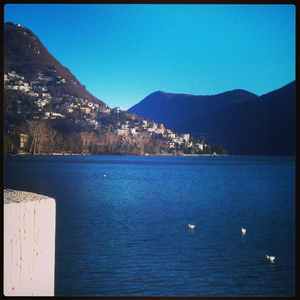 Photo taken at Lago di Lugano by Andrea M. on 12/28/2012