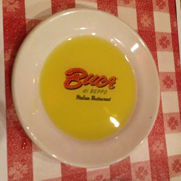 Photo taken at Buca di Beppo Italian Restaurant by Ilenia M. on 5/21/2013