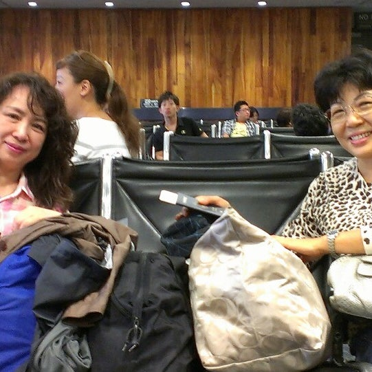 Photo taken at Gate 24 by Ruyi L. on 9/20/2013