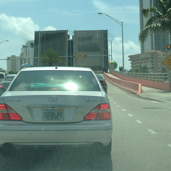 Photo taken at Waiting For The Hallandale Bridge by Lauren K. on 5/27/2013