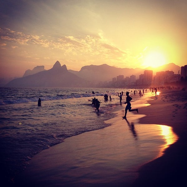 Photo taken at Praia de Ipanema by Dimitri P. on 5/5/2013