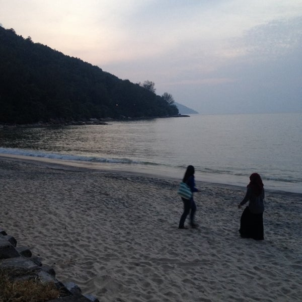 Photo taken at Teluk Bahang Beach by Fara Z. on 6/21/2014
