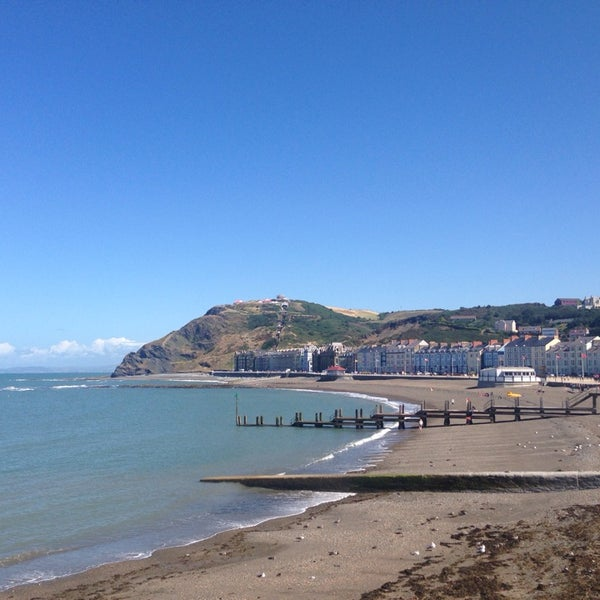 Photo taken at Aberystwyth Beach by Phil S. on 8/3/2013