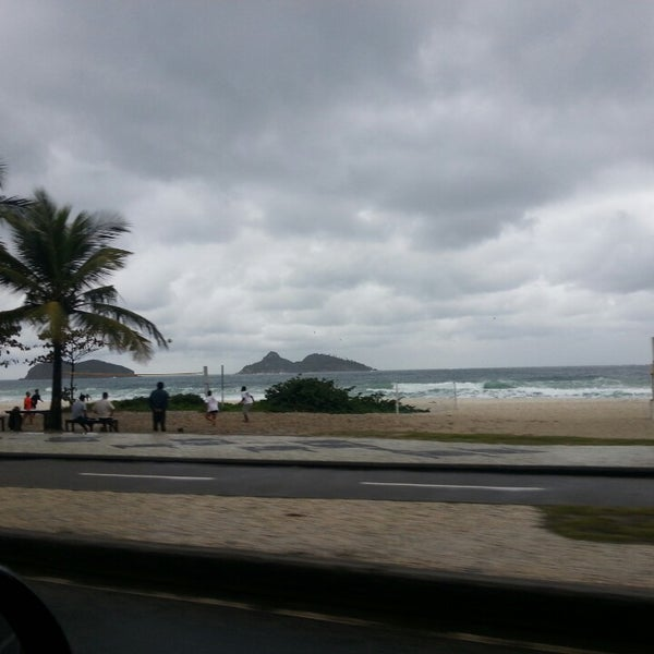 Photo taken at Praia da Barra da Tijuca by Evandro T. on 7/25/2013