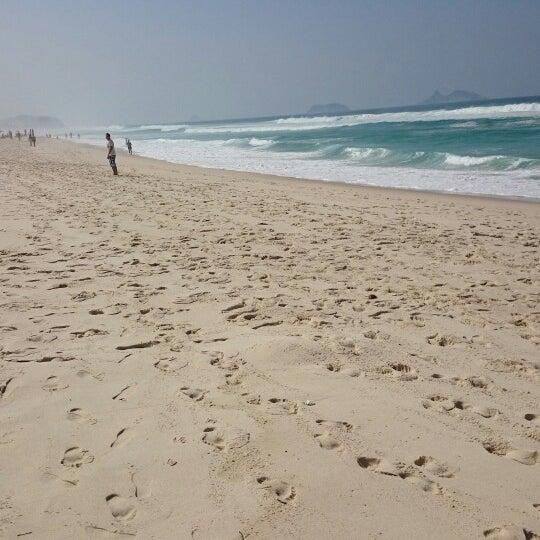 Photo taken at Praia da Barra da Tijuca by Vinícius T. on 9/13/2014