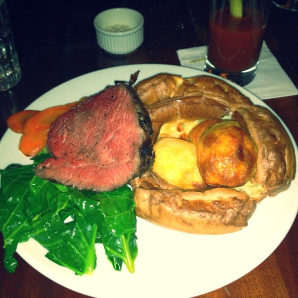 Photo taken at Hawksmoor Seven Dials by Ekaterina C. on 2/3/2013