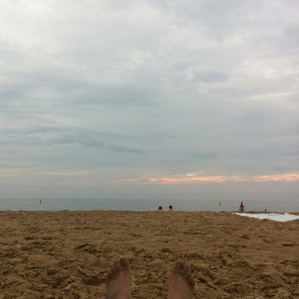 Photo taken at Silver Beach by Juan J. on 7/6/2013