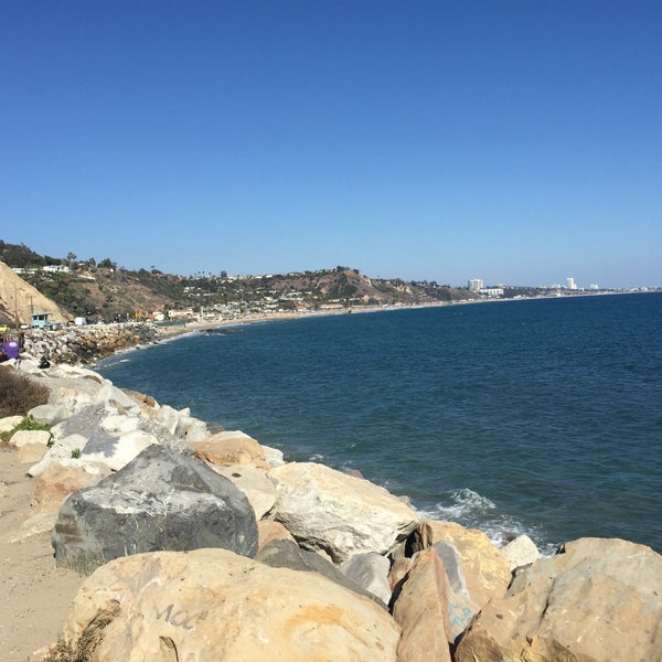 Photo taken at Pacific Palisades Beach by Sahoua G. on 8/9/2015