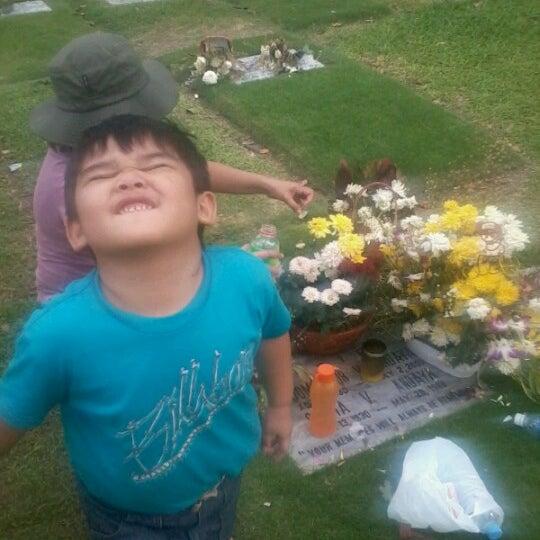 Photo taken at Manila Memorial Park by Elle C. on 11/4/2012