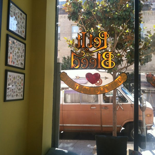 Photo taken at Let It Bleed Tattoo by Chloe C. on 8/13/2013