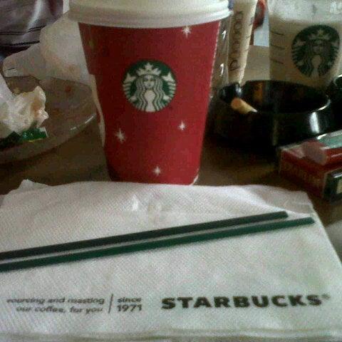 Photo taken at Starbucks by Christiano V. on 12/26/2012