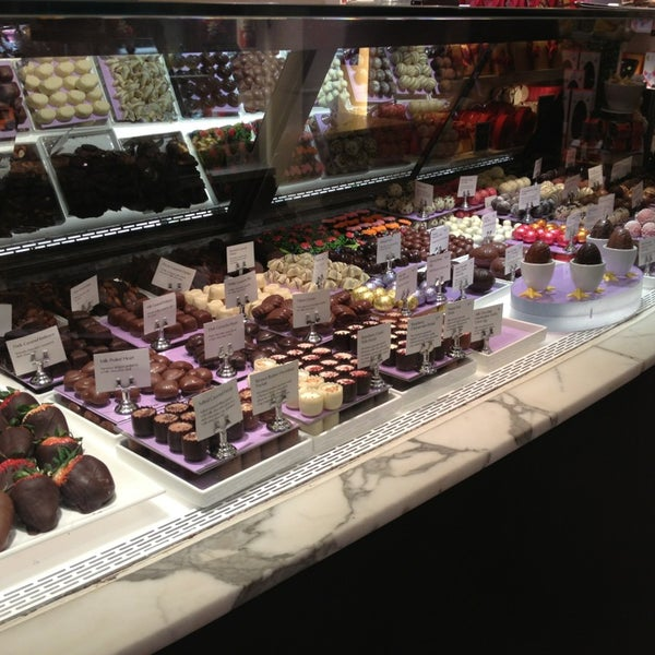 Photo taken at Godiva Chocolatier by Elleen on 3/1/2013