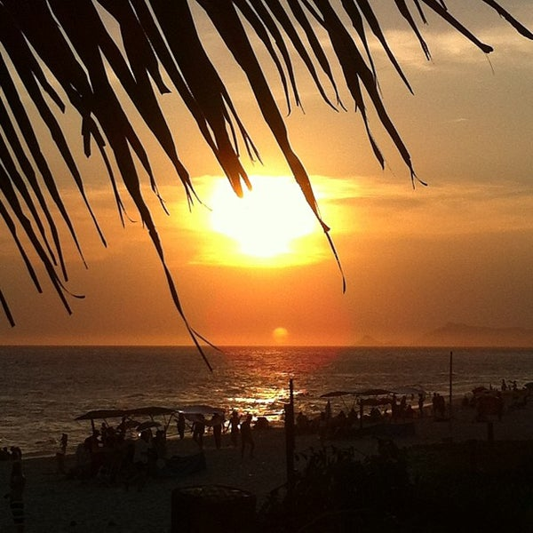 Photo taken at Praia da Barra da Tijuca by Denise on 1/1/2013