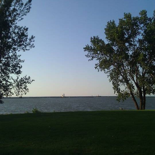 Photo taken at Whiskey Island Volleyball Courts by Dave D. on 8/15/2011