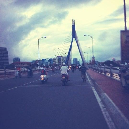 Photo taken at Cầu Sông Hàn (Han River Bridge) by NamMuw on 10/7/2012