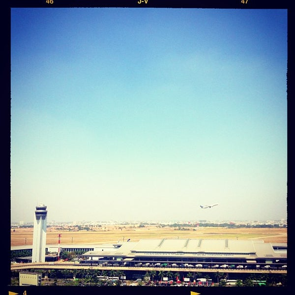 Photo taken at Tan Son Nhat International Airport (SGN) by Long T. on 2/18/2013