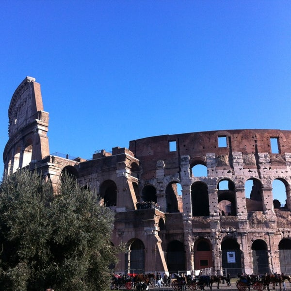Photo taken at Piazza del Colosseo by Nataliya on 1/5/2013