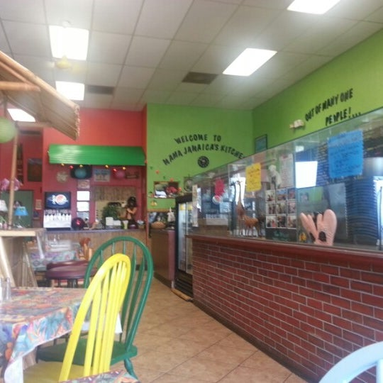 Photo taken at Mama Jamaica's Kitchen by Marcus on 9/28/2012
