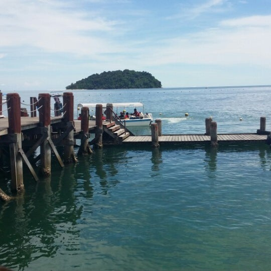 Photo taken at Manukan Island Jetty by Noor H. on 6/7/2014