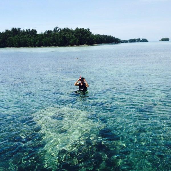 Photo taken at Pulau Pramuka by Adie M. on 3/22/2015