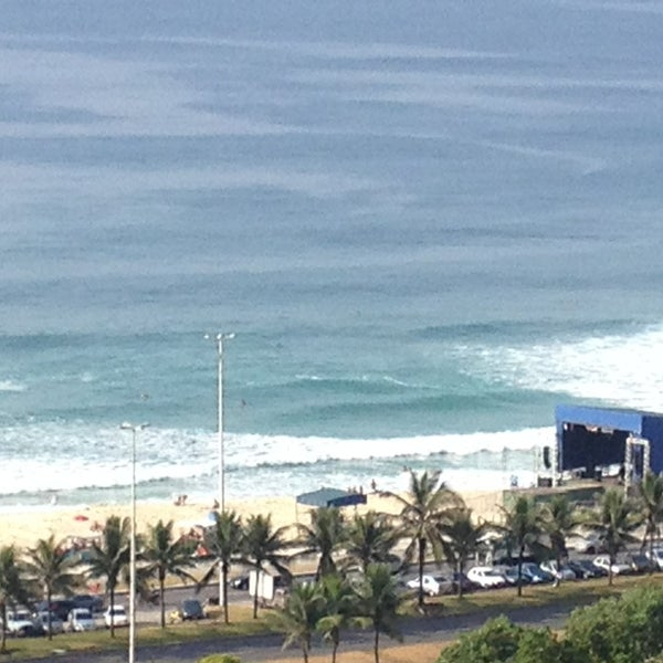 Photo taken at Praia da Barra da Tijuca by Lara C. on 12/31/2012
