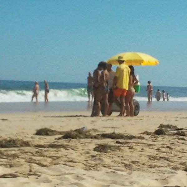 Photo taken at Praia do Barril by Ana G. on 6/24/2013