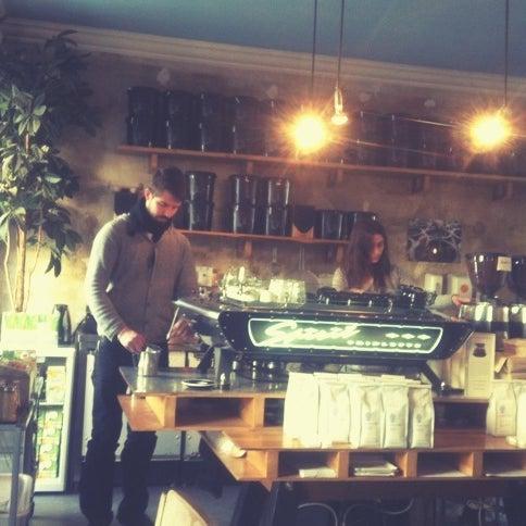 Photo taken at Bonanza Coffee Heroes by Julia G. on 10/12/2012