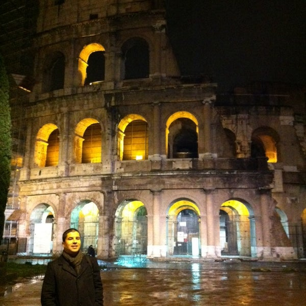 Photo taken at Piazza del Colosseo by Cristiano R. on 3/1/2014