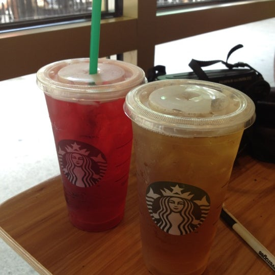 Photo taken at Starbucks by Jo R. on 7/3/2012