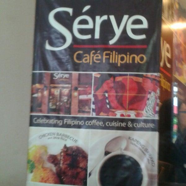 Photo taken at Sérye Café Filipino by Jeremiah L. on 6/16/2013