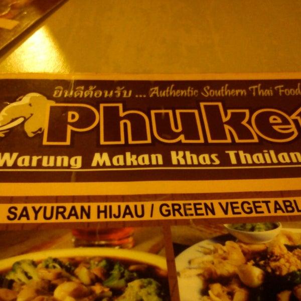 Photo taken at Phuket Thai Resto by cristiee v. on 7/6/2013