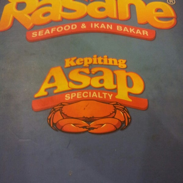 Photo taken at Rasane Seafood & Ikan Bakar by Albert T. on 8/7/2013