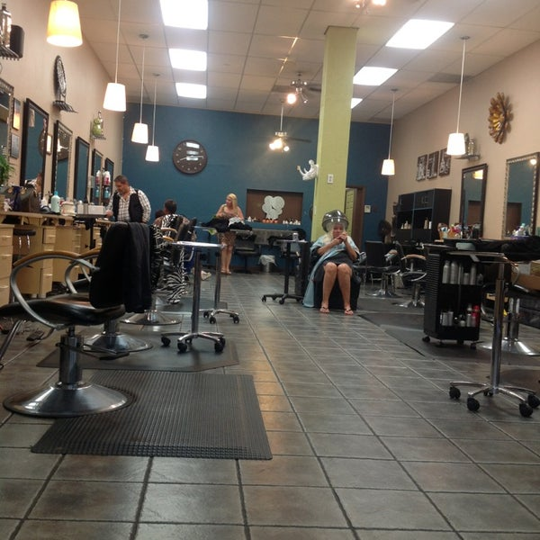 Photo taken at Split Endz Hair and Nails by Derek S. on 6/29/2013