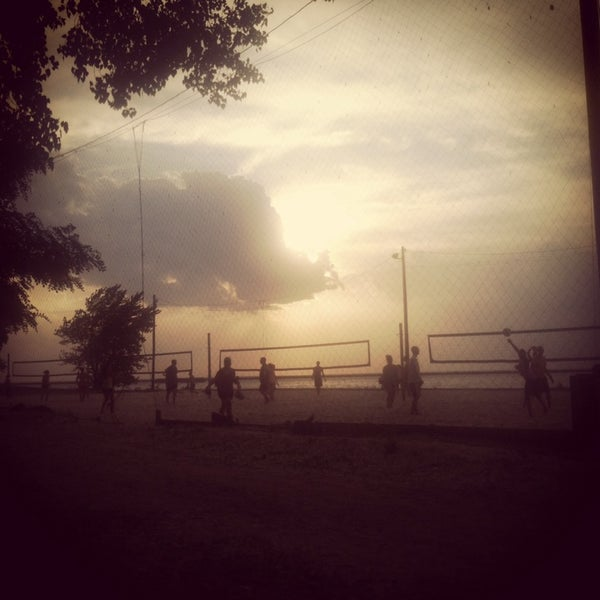 Photo taken at Whiskey Island Volleyball Courts by Jeffrey H. on 6/18/2014