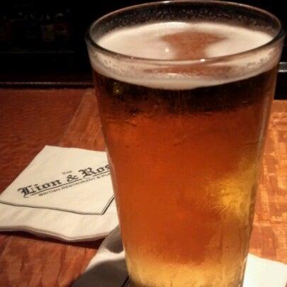 Photo taken at The Lion & Rose British Restaurant & Pub by Scott M. on 12/26/2012