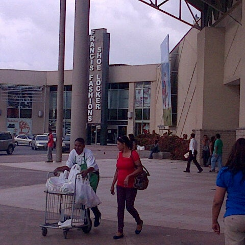 Photo taken at Trincity Mall by Vincent R. on 6/14/2013