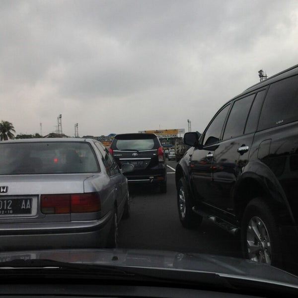 Photo taken at Gerbang Tol Cililitan by Vincentius I. on 1/28/2014