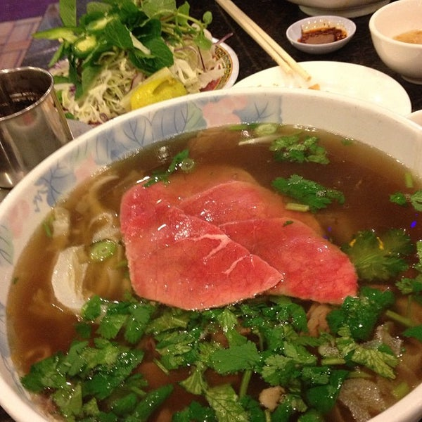 Photo taken at Pho Kim Long by Toru M. on 2/15/2013