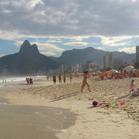 Photo taken at Praia de Ipanema by Bruno M. on 6/29/2013
