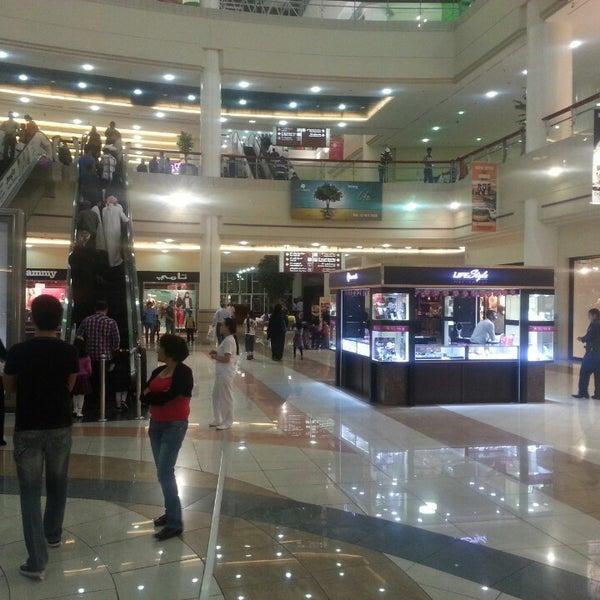 Photo taken at Mushrif Mall by Abu F. on 3/15/2013