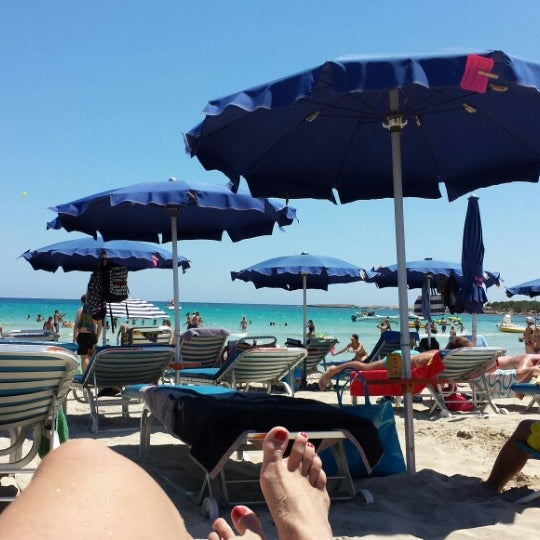 Photo taken at Makronissos beach by Alyona P. on 6/22/2014