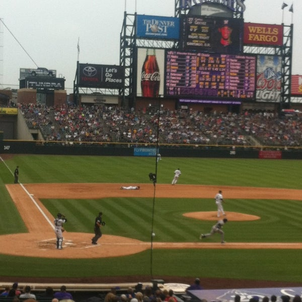 Photo taken at Coors Field by Tina L. on 7/28/2013
