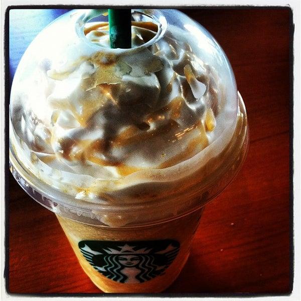 Photo taken at Starbucks by Vitor F. on 4/8/2012