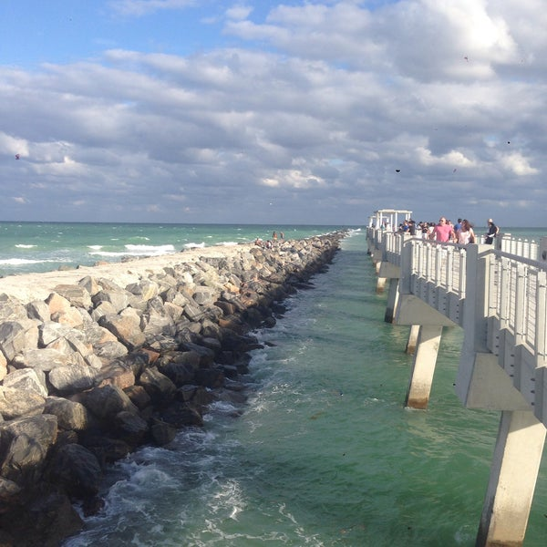 Photo taken at South Pointe Pier by Oxana B. on 11/24/2015