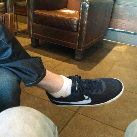 Photo taken at Starbucks by Lizzie E. on 7/19/2014