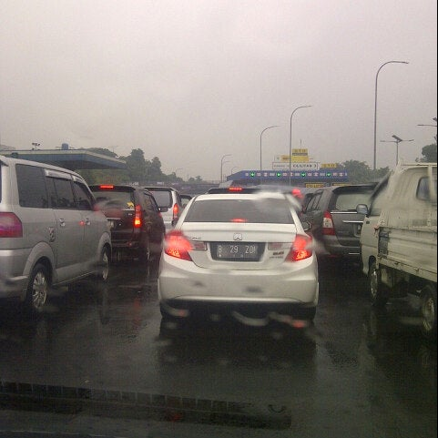 Photo taken at Gerbang Tol Cililitan by Jonson S. on 2/8/2014