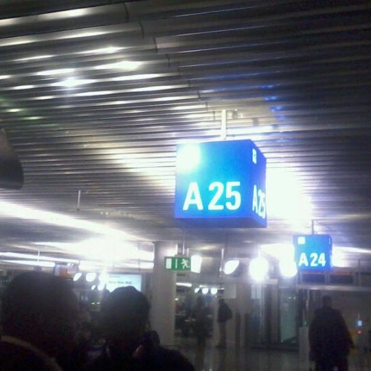 Photo taken at Gate A25 by Momo A. on 1/3/2012