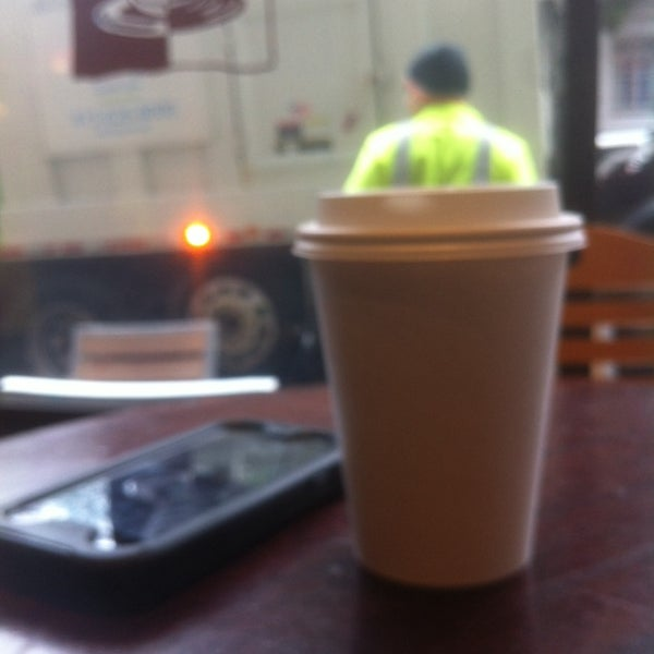 Photo taken at Cup-A-Joe Coffee House by Slava S. on 1/8/2014