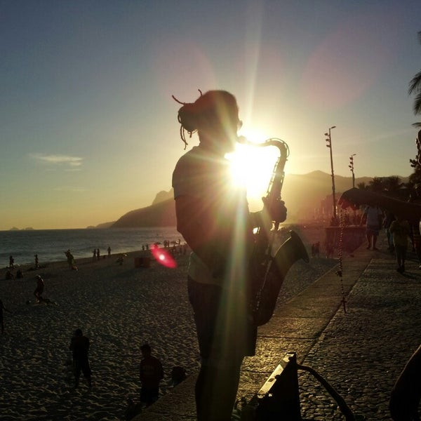 Photo taken at Praia de Ipanema by Gilson M. on 3/14/2014